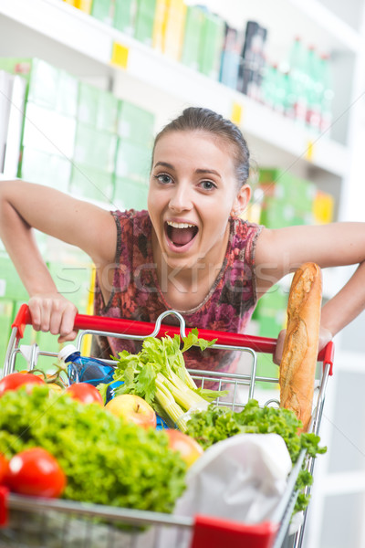 Full shopping cart at supermarket Stock photo © stokkete