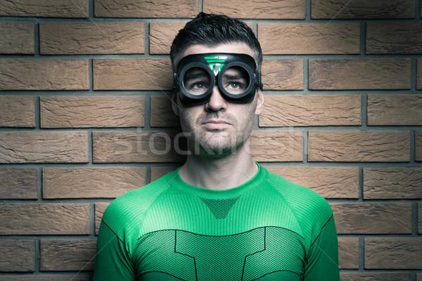 Pensive superhero looking up Stock photo © stokkete
