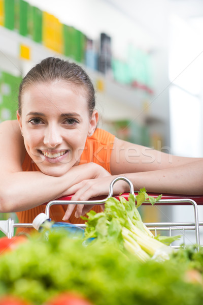 Attractive woman leaning on trolley Stock photo © stokkete