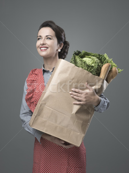 Vintage woman with grocery bag Stock photo © stokkete