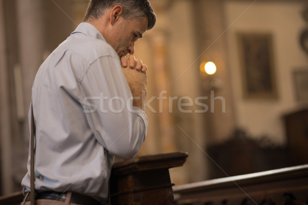 Religious man in the Church Stock photo © stokkete