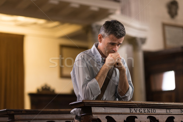 Man praying in the Church Stock photo © stokkete