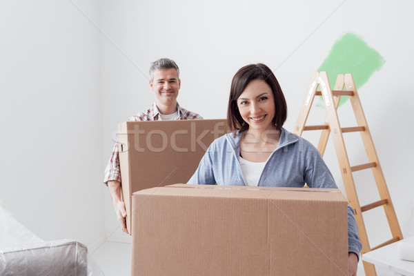 Couple moving into a new house Stock photo © stokkete