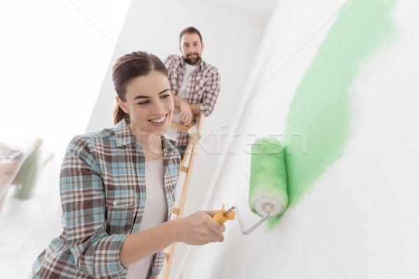 Couple renovating their new house Stock photo © stokkete