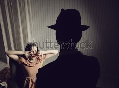 Killer pointing the gun at a terrified woman Stock photo © stokkete