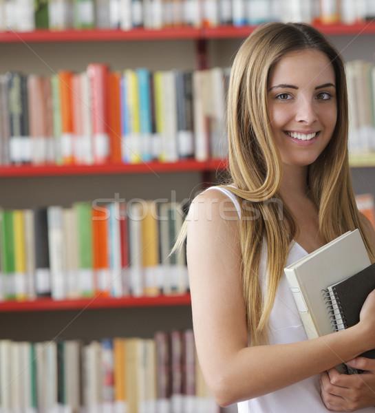 Сток-фото: студент · портрет · молодые · улыбаясь · библиотека · образование
