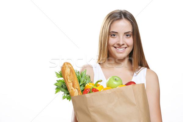 élelmiszer vásárlás portré mosolyog fiatal nő tart Stock fotó © stokkete