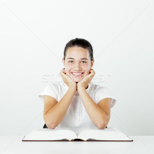 Dziewczyna student młodych uśmiechnięty otwarta księga książki Zdjęcia stock © stokkete