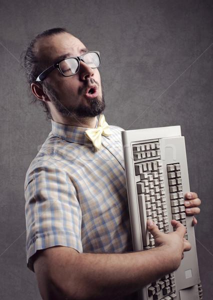 Bilgisayar senfoni komik adam oynama klavye Stok fotoğraf © stokkete