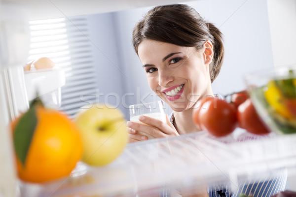Woman having a glass of milk Stock photo © stokkete