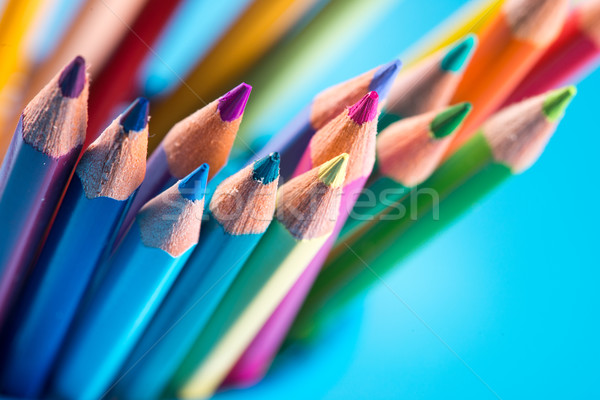 Multicolor pencils on blue background Stock photo © stokkete