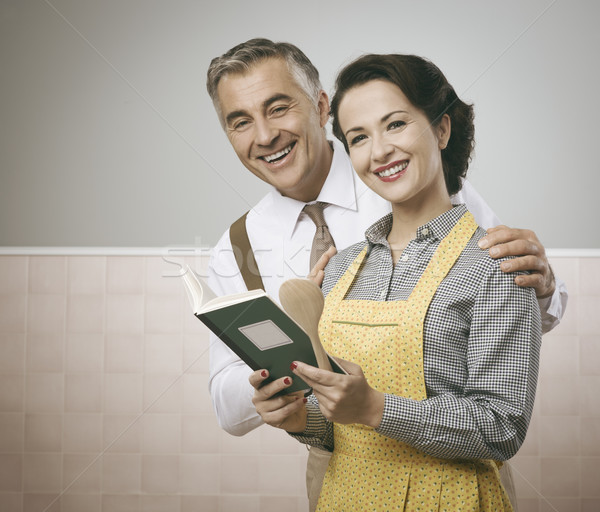 Wife and husband reading a cookbook together Stock photo © stokkete