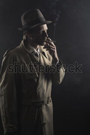 1950s style agent smoking a cigarette Stock photo © stokkete