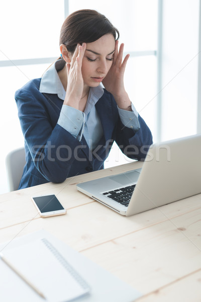 Exhausted businesswoman at work Stock photo © stokkete
