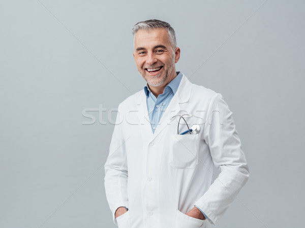 Cheerful doctor posing Stock photo © stokkete