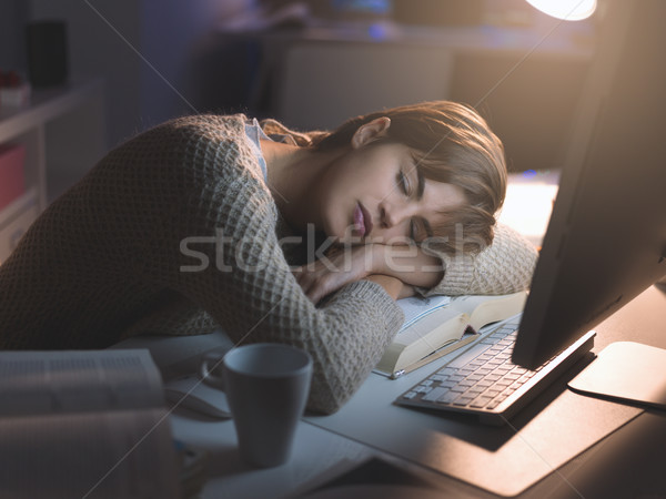 Stock photo: Tired woman sleeping on the desk