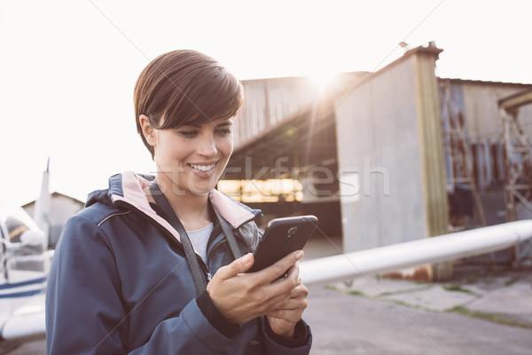 Smiling woman at the aerodrome Stock photo © stokkete