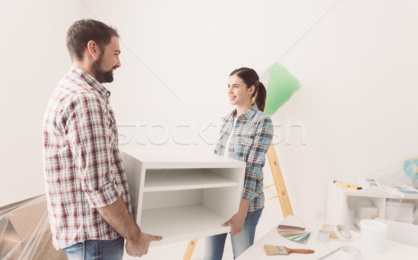Couple moving furnishings in their new house Stock photo © stokkete