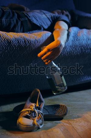 Fumare congiunto home giovane divano uomini Foto d'archivio © stokkete