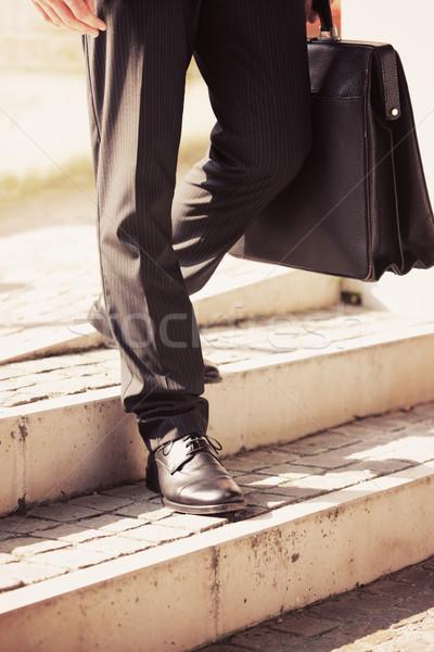Empresário pasta para baixo escada homem homem de negócios Foto stock © stokkete