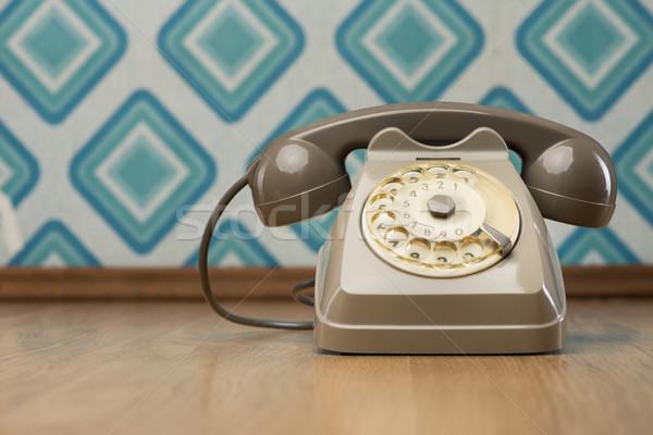 Vintage telephone on diamond wallpaper Stock photo © stokkete