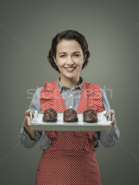 Smiling woman serving chocolate muffins Stock photo © stokkete