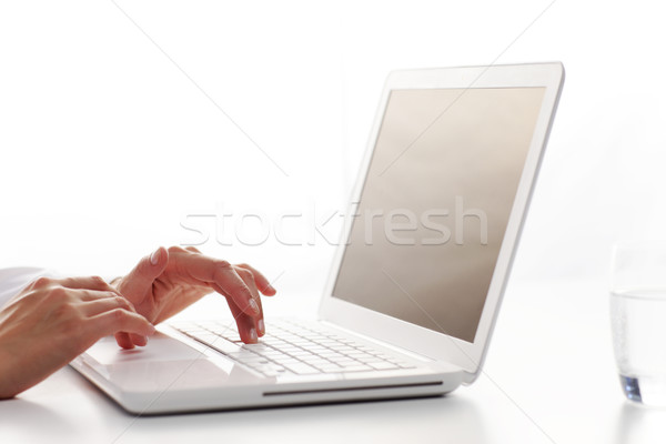 Female hands typing on a white computer keyboard Stock photo © stokkete