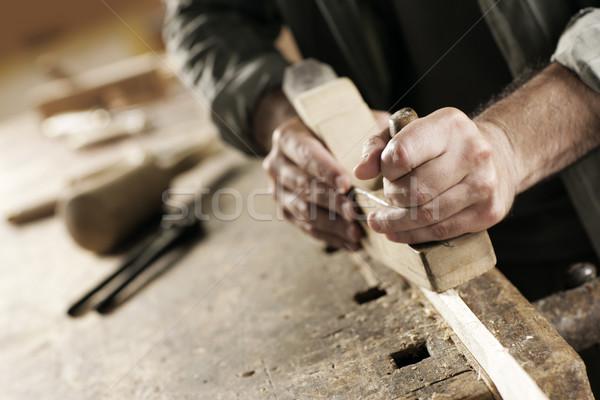 Kezek kézműves ács fa munkahely építkezés Stock fotó © stokkete