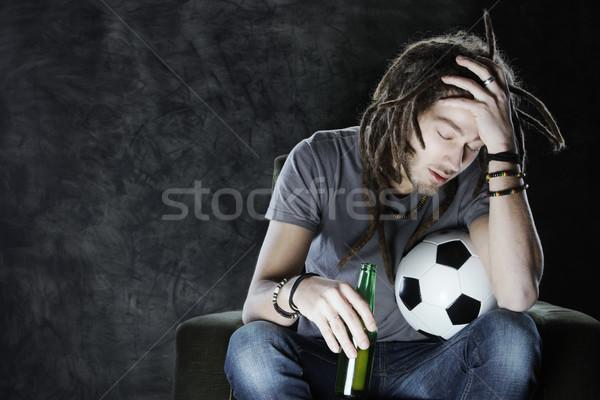 Piłka nożna fan oglądanie telewizji piłka nożna dorosły człowiek Zdjęcia stock © stokkete