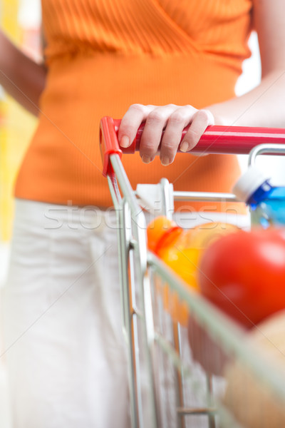 Woman at supermarket with trolley Stock photo © stokkete