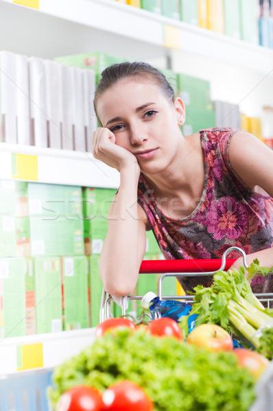 исчерпанный женщину супермаркета магазине полный Сток-фото © stokkete