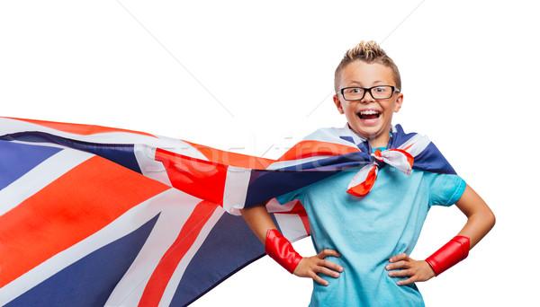 Uśmiechnięty superhero stwarzające cute chłopca broni Zdjęcia stock © stokkete