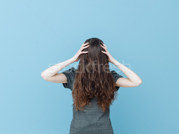 Woman with face covered behind her hair Stock photo © stokkete