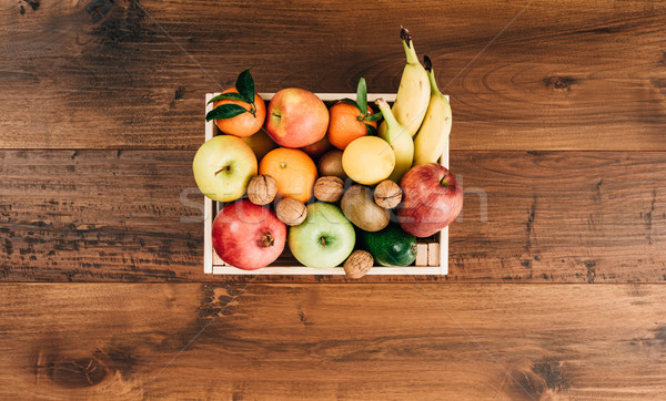Fresh tasty fruit in a wooden crate Stock photo © stokkete
