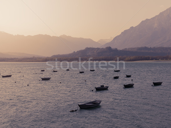 Mountain lake and moored boats Stock photo © stokkete