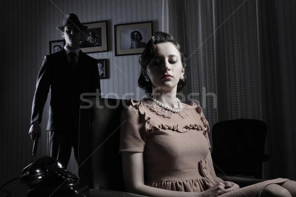 Gengszter fegyver gyönyörű nő előtér férfi pár Stock fotó © stokkete