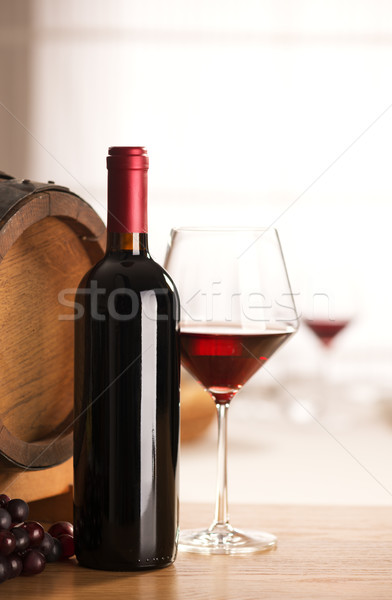 Wine glass and bottle still life Stock photo © stokkete