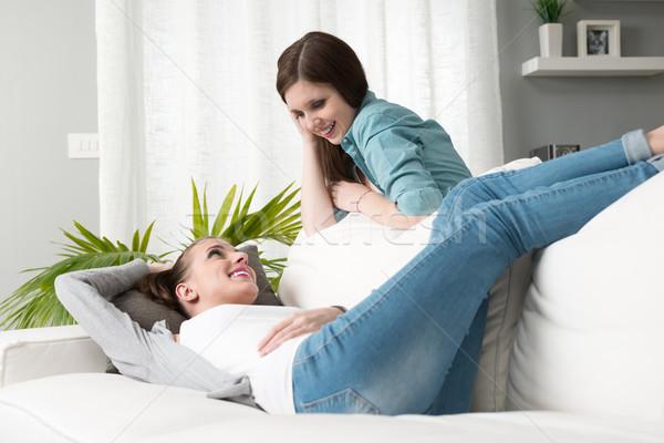 Gülen oturma odası genç kızlar Stok fotoğraf © stokkete