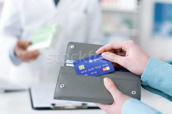 Woman buying products in the pharmacy Stock photo © stokkete