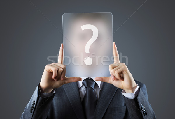 Young business man holding question mark signs Stock photo © stokkete