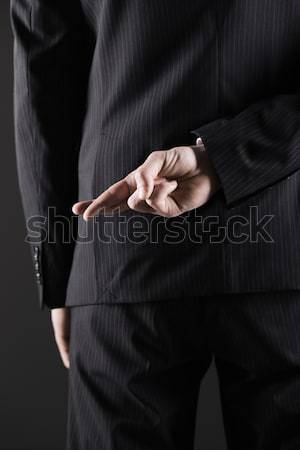 Concept for dishonesty or fraud Stock photo © stokkete