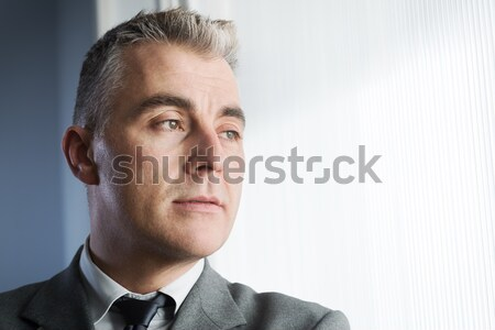 Pensive businessman looking away Stock photo © stokkete