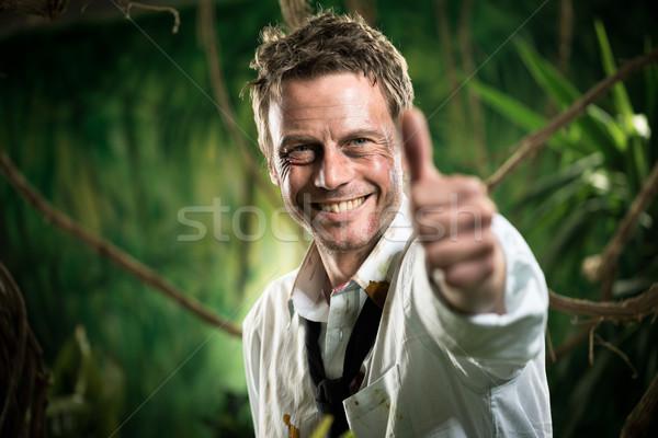 Bem sucedido empresário vitória rasgado roupa sorridente Foto stock © stokkete