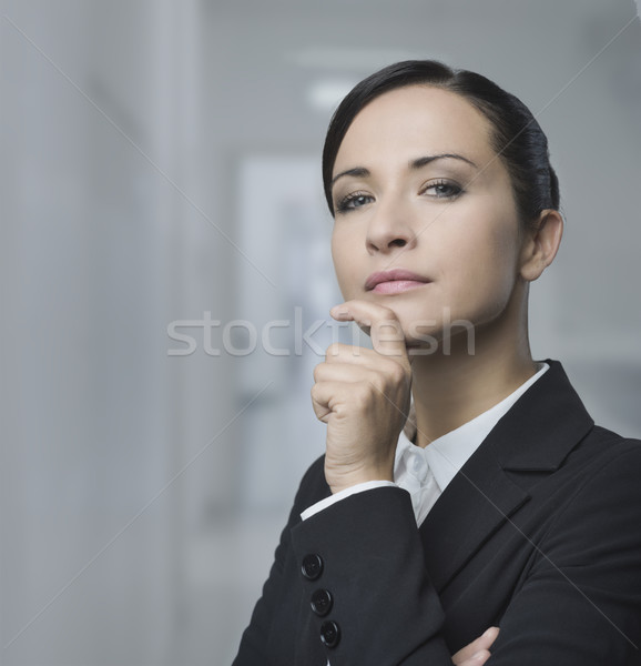 Confident female manager with hand on chin Stock photo © stokkete