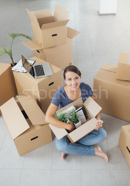 Beautiful woman unpacking in her new house Stock photo © stokkete