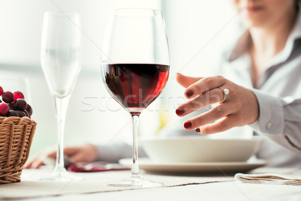 Woman tasting wine and having lunch Stock photo © stokkete