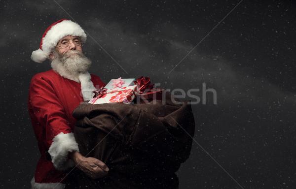 Santa Claus bringing gifts Stock photo © stokkete