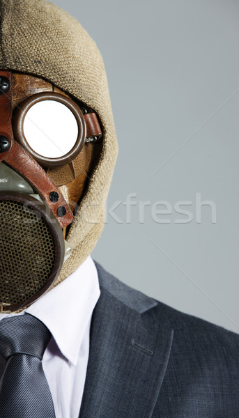 portrait of businessman in a gas mask Stock photo © stokkete