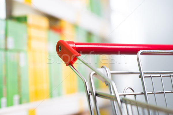 Supermarket trolley at store Stock photo © stokkete