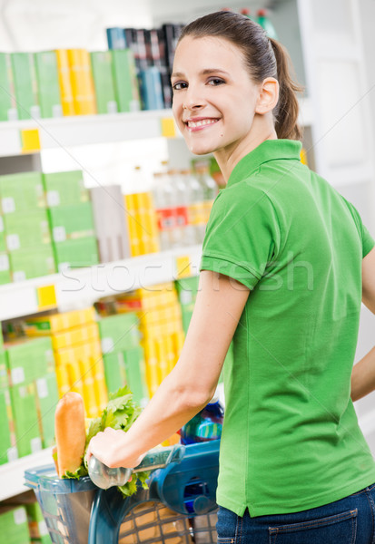 Smiling woman shopping at supermarket Stock photo © stokkete